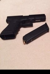 Josh Taylor uploaded this photograph of a handgun to his Facebook page.