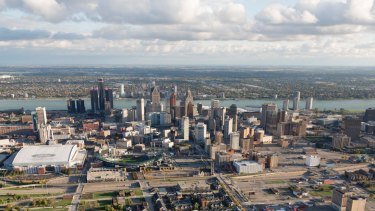 The Detroit city centre with Windsor, Ontario, on the horizon, across the Detroit River which forms the US-Canada border.