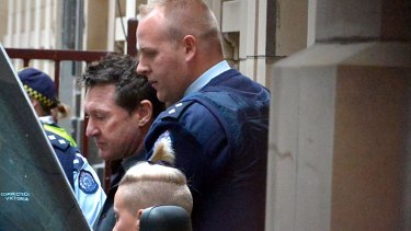Steven Hunter is led out of the  Melbourne Supreme Court after being sentenced to life imprisonment without parole.