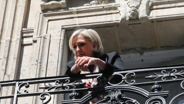 Marine Le Pen appears on the balcony of her campaign headquarters in Paris on Monday.