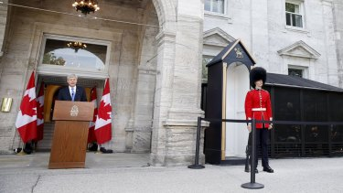 Canadian Prime Minister Stephen Harper door stops at Rideau Hall after asking Governor General David Johnston to dissolve Parliament on Sunday.