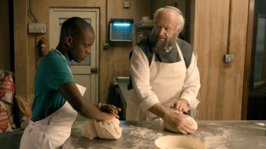 Jerome Holder and Jonathan Pryce as Ayyash and Nat in Dough.