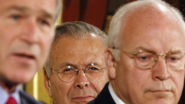 Former president George W. Bush, left, secretary of defence Donald Rumsfeld and vice-president Dick Cheney, who held top roles in the United States when it launched the war in Iraq.