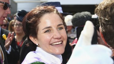 Michelle Payne celebrates after riding Prince of Penzance to win the 2015 Melbourne Cup
