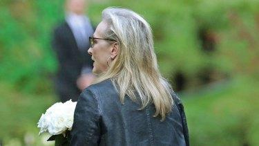 Actress Meryl Streep arrives with flowers.