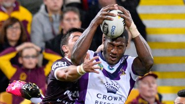 Aerial mismatch: Suliasi Vunivalu out jumps Kodi Nikorima to score.