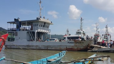 The ambulance transporting Zulfiqar Ali to Nusakambangan boards a ferry at Cilacap's port.