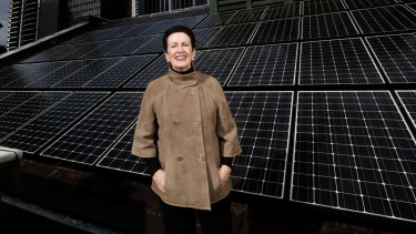 Clover Moore, Mayor of Sydney,  on the roof of Sydney Town Hall with solar panels.