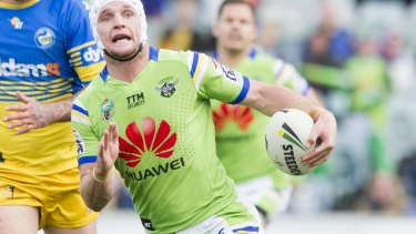 Raiders captain Jarrod Croker on the attack with TTM Security appearing on his jersey above major sponsor Huawei.