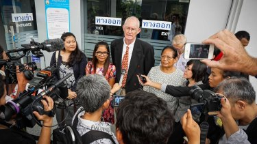 Alan Morison and Chutima Sidasathian, second from left, at the courthouse in Phuket after their acquittal.