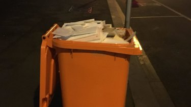 The unlocked bin fllled with confidential documents left on the street in Melbourne's legal precinct.