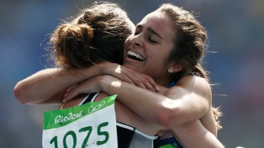 Respect: Abbey D'Agostino, right, hugs Nikki Hamblin.