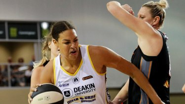 Liz Cambage of Melbourne Boomers drives to the basket in game three of the WNBL final series.
