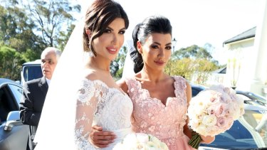 Kat Mehajer arrives at her wedding  with brother Salim's date Constance Siaflas.