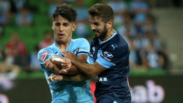 Redemption: Michael Zullo, left, tangles with Melbourne City's rising star Daniel Arzani.