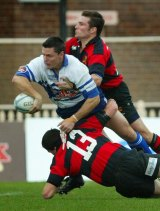 Those were the days: Yours truly offloads a pass for Eastwood against Norths in 2003.