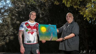 Indigenous through and through: Dragons forward Joel Thompson with artist Kevin Butler, who designed St George Illawarra's jersey last year.