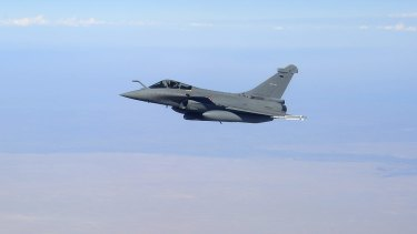 A French Air Force Dassault Rafale F1 aircraft in the skies of Iraq.
