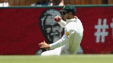 Substitute fielder for Australia Jonny Wells takes the catch to dismiss New Zealand's Ross Taylor at the WACA.