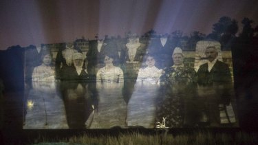 Photographs and paintings from the National Museum of Australia's collections are projected onto rolling fog and the waters of the Murrumbidgee River by artist-in-residence Vic McEwan and curator George Main. Ghostly faces of pioneers long past.