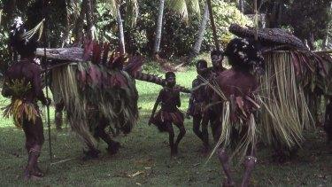 Crocodile masks being danced in ceremony at Yentachan village in 1981.