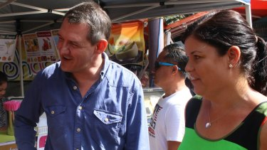 Northern Territory chief minister elect Michael Gunner and Attorney General Natasha Fyles (right) greet locals at Darwin's Nightcliff Markets on Sunday morning,