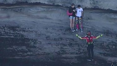 Two girls have been winched to safety from the rocks at North Head, near Manly.