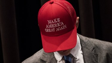"An attendee wears a hat reading ""Make America Great Again"" before a campaign event at Youngstown State University in Youngstown, Ohio."