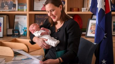 Kelly O'Dwyer in her office with her newborn son.