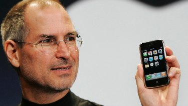 Apple CEO Steve Jobs with the first iPhone, which has just turned 10 years old.