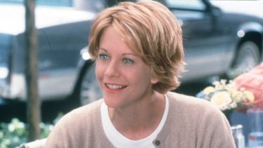 Meg Ryan and her very '90s hair  in the film <i>You've Got Mail</I>.