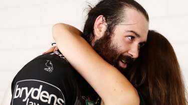 Farewell? Tigers chair Marina Go hugs Aaron Woods following their upset win over the Cowboys.