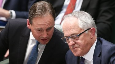 Environment Minister Greg Hunt, left, confers with Prime Minister Malcolm Turnbull.