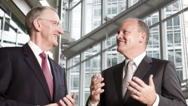 IAG chief executive Mike Wilkins, left, is stepping down to be succeeded in November by Peter Harmer. The insurance company has scrapped plans to expand in China.