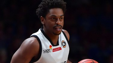 No way round: Casper Ware of Melbourne United. Adelaide were just too strong for the visitors.