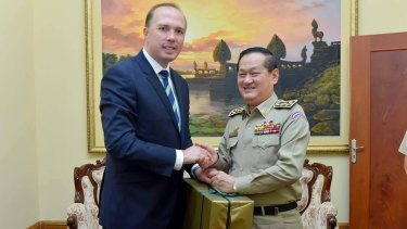 Australian Immigration Minister Peter Dutton with Sok Phal, director of the Cambodian Interior Ministry's immigration department last year.