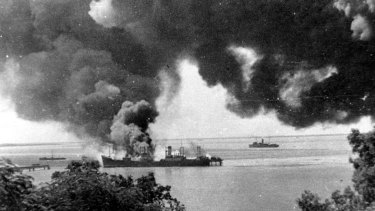The SS Barossa burns after being bombed by the Japanese.