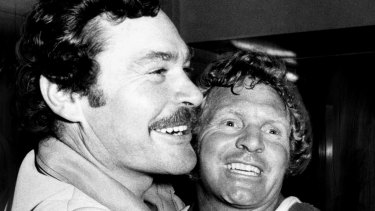 North Melbourne coach Ron Barassi and star Barry Cable after the win over Richmond in the preliminary final in 1975.