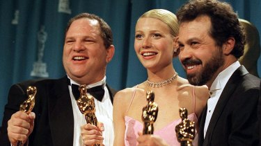 """Weinstein with Gwyneth Paltrow and their Oscars for """"Shakespeare In Love""""."""