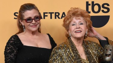 Carrie Fisher, left, and Debbie Reynolds at the 21st Annual Screen Actors Guild Awards in 2015.