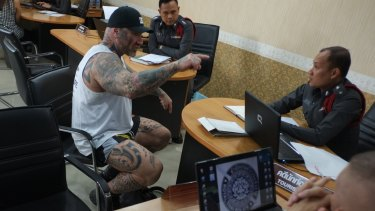 'I am not going anywhere': Tim Ward confronts police at the Pattaya Beach station, accusing them of planting drugs in his apartment.