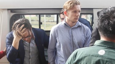 Nick Kelly, second left, and Thomas Whitworth, centre, arrive in court on Thursday.