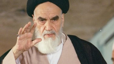 Then Iranian leader Ayatollah Ruhollah Khomeini greets well-wishers before casting his vote in 1988.