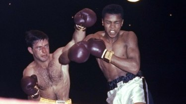 """Hard as nails"": Tony Madigan fighting Cassius Clay, later Muhammad Ali, in 1959."