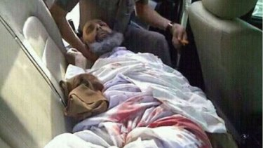 Sheikh Nimr lies wounded in the back of a Saudi police car on July 8, 2012, the day of his arrest.