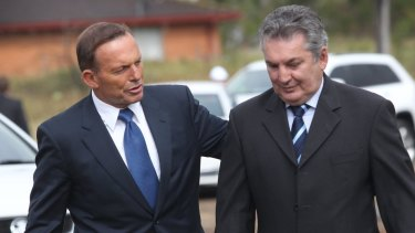 Former Macarthur MP Russell Matheson (right) is pictured with Tony Abbott.