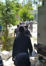 A photo appearing to show the arrest of refugee Behrouz Boochani at the camp on Thursday.