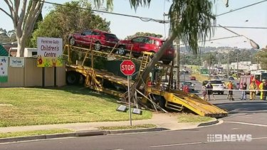 The scene where a car-carrier ran into a power pole before crashing into a childcare centre at Ferntree Gully on Thursday.