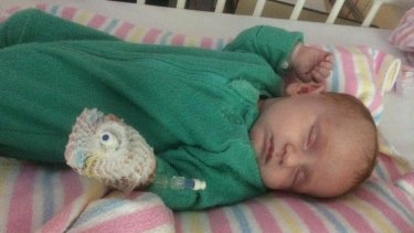 Grace, pictured in hospital, was prescribed with medication above the dose recommended for a child of her age and size.