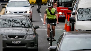 Under a new road rule, motorists would have to keep a one-metre buffer between their car and cyclists.